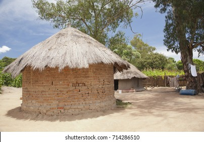 The country house in Zimbabwe, typical village of African peasants. Simple clay house with a thatched roof.