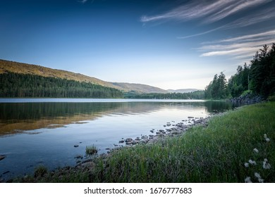 Country lake near Jettegrytene river at dusk calm and relax Norway