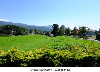 Country landscape of pasture field with background of mountains, Kiyosato highland, Yamanashi, Japan