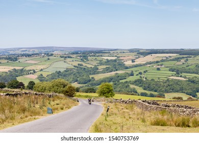 Country Lane.  A motorbike travels along a country lane in the North York Moors National Park, England.
