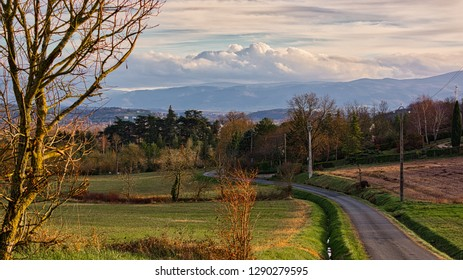 Country lane with vista of Black Mountains in Occitania France