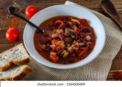 Country man stew from red beans, tomatoes and sausages