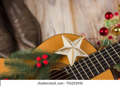Country music background with acoustic guitar and christmas decoration