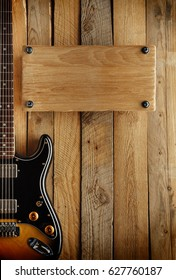 country music board with electric guitar on old wooden wall