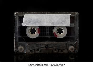 Country Music  Mixtape A Country Music Cassette tape with a back background.