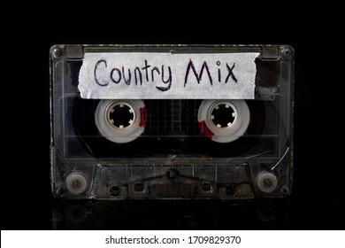 Country Music Mixtape Ein Country Music Cassette-Band mit einem Hintergrund.