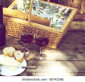Country picnic for two with wine, bread and cheese.
