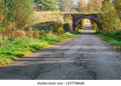 country road, arch bridge over the road