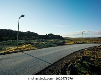 Country road in an area with green moss and small rocks in Iceland. Backplate for automobile industry and cgi.