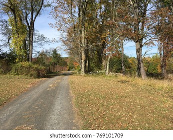 Country road in an autumn scene. Fall foliage in New England.