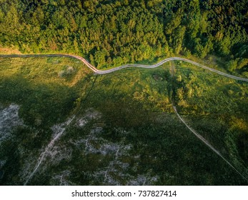 A country road curves through the old quarry
