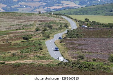 Country road cuts across Exmoor National park near Minehead in Somerset, England.