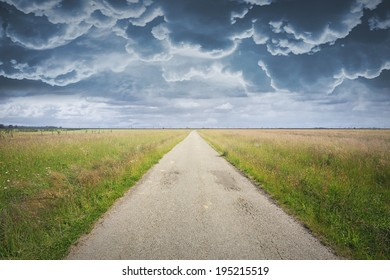 Country road and dramatic cloudscape. Background for photo manipulation