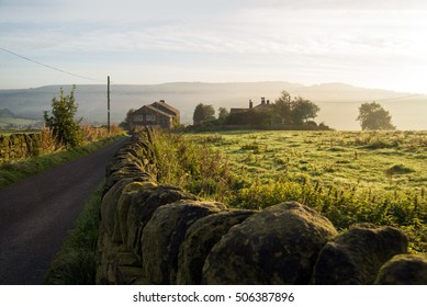 Country road and dry stone wall at Yorkshire, UK