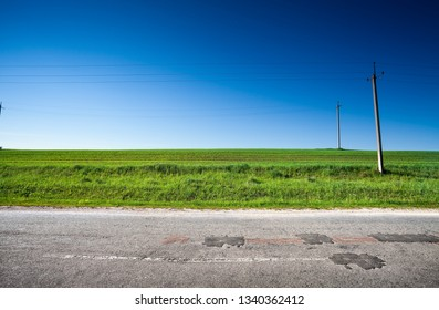 Country road and green field, rural scene