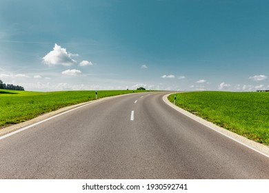 Country road in green landscape to the horizon