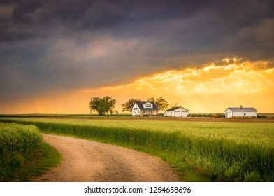 Country Road with the Idyllic Midwestern Farmhouse Background