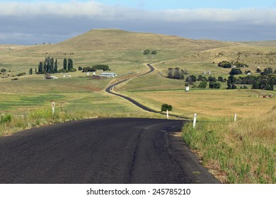 Country road leading up into the hills near Dalgety, NSW, Australia