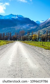 Country road with mountain and snow