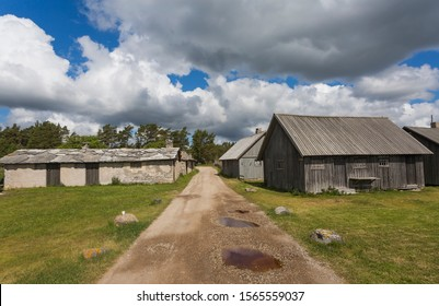 A country road on the island Gotland, Sweden in the Baltic sea with old houses for the fishermen on the both sides