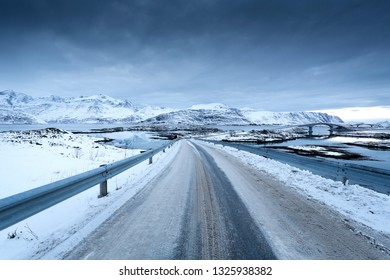 Country road on the Lofoten islands, Norway, Europe, in winter