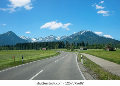country road from rubi to oberstdorf tourist spa town in spring. beautiful allgau landscape germany