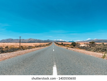 Country road in a South African Karoo desert landscape