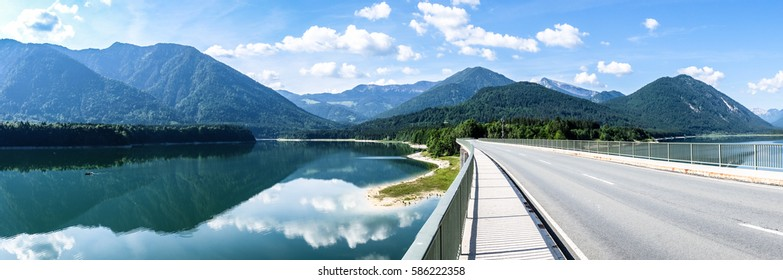 country road at the sylvenstein lake - bavaria