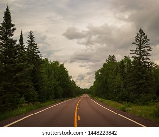 country road through dense north woods