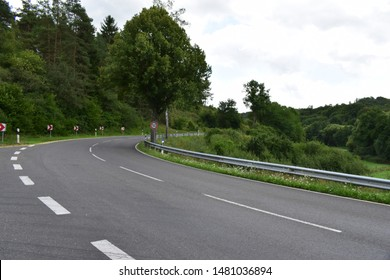 country road through Eifel forest