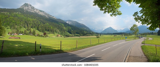 country road through rural allgau landscape from rubi to oberstdorf health resort