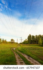 Country road under the electric transmission line in summer