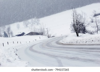 A country road in winter in heavy snowfall