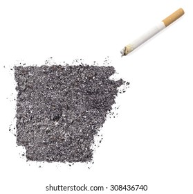 The country shape of Arkansas made of tobacco ash and a cigarette.