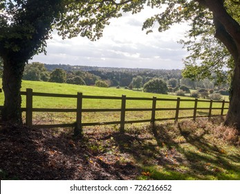 country side open rolling fields below with wooden fence up front; Essex; England; UK