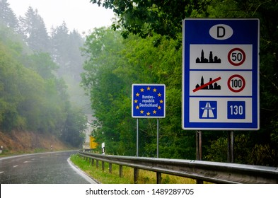 Country sign of the Federal Republic of Germany (Bundesrepublik Deutschland) with speed limit sign