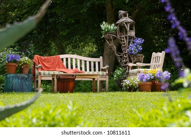 country sun drenched garden with a out door sitting area