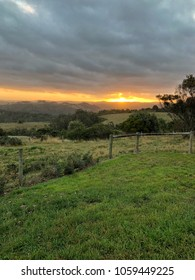 Country Sunset over looking rolling hills and pasture land