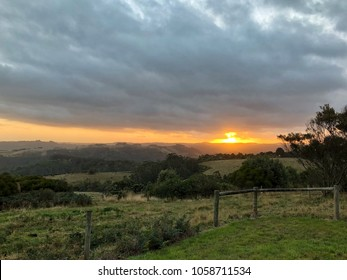 Country Sunset over rolling hills in Country setting