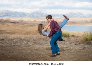 Country swing dancing at the foothill of mountains.