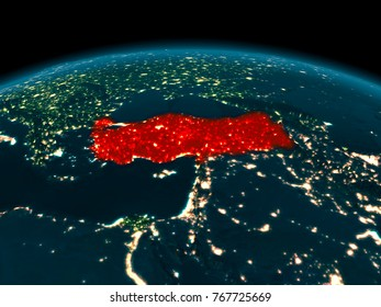 Country of Turkey in red on planet Earth at night. 3D illustration. Elements of this image furnished by NASA.