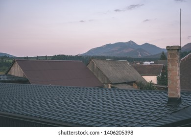 country village rooftops in Slovakia with mountains in background - vintage retro look