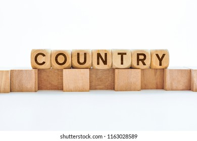 Country word on wooden cubes