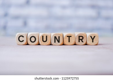 Country word written on wood block