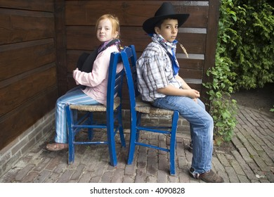 country-kids sitting backwise to each-other