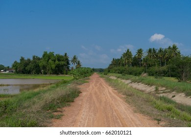 countryRough road with blue sky