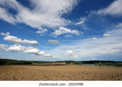 Countryside in Czech Republic. Plowed earth of a rural field.