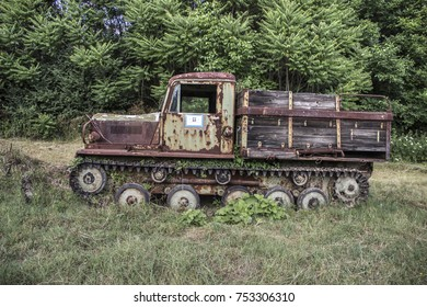 Countryside, East Serbia - Old rusty crawler truck abandoned in a meadow