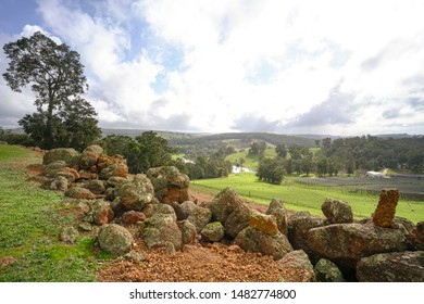 Countryside farm land landscape view with stones at the foreground