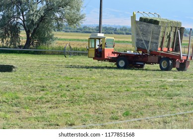 Countryside with haying machinery.